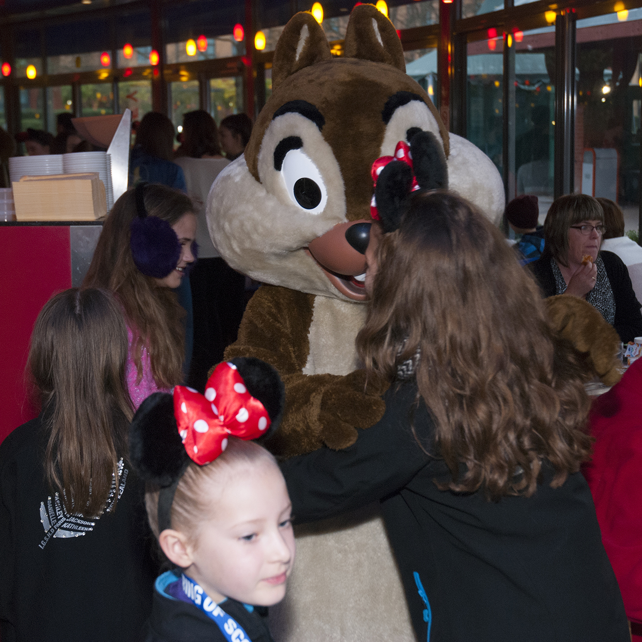 Pluto enjoying breakfast with smiling guests